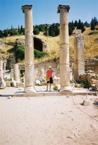 Holding up an ancient Greco-Roman pillar in Ephesus.