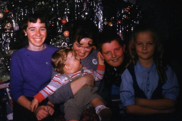 Josie Helm, Juanita Helm, brother Ray and Tom and me at Christmas ca. 1960