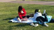 Students enjoying 60-degree February weather on the Oval at Ohio State.