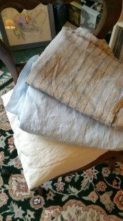New linen: ultra-lightweight bleached; pale blue lightweight; and natural with blue stripes medium weight.