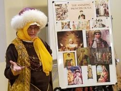 Olga Flaming Gryphon 1.6.18--Olga paintings--smiling--cropped