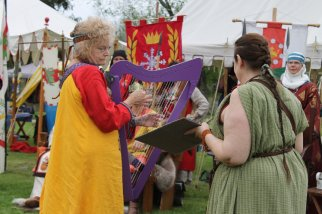 me and Janet VanMeter doing Havamal at Evening Court, Coronation, May 5, 2018
