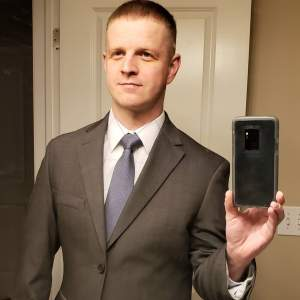 Jason second day at PACE job in suit for official photo